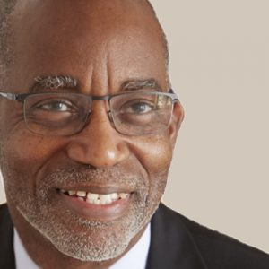 A headshot of David R Williams