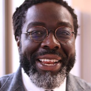 A headshot of Victor Adebowale