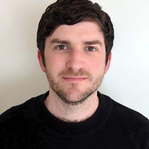 A headshot of Sam Roger
